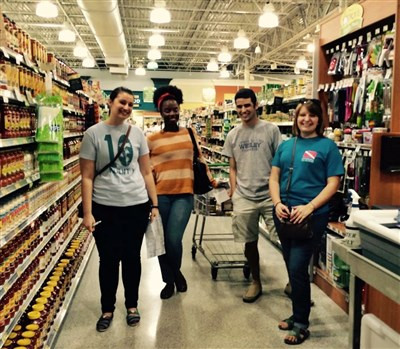 Jacksonville YAMM participants in a shopping aisle buying groceries together
