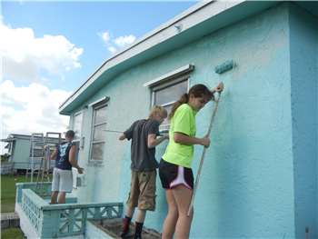Teens from First UMC, LaPorte, Ind., paint a house as part of a mission trip