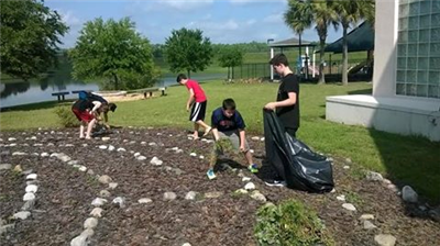 Youth from Peace UMC spruce up the grounds at their church