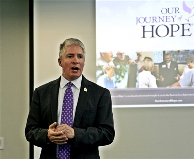 "Rev. Chip Gordon of CTCA near Atlanta with ""Our Journey of Hope"" video on screen"