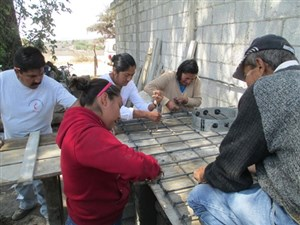 Local residents learn to make a water-less toilet at the United Methodist mission project in Puebla, Mexico.