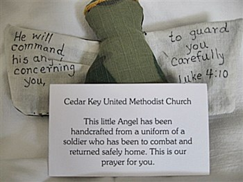Angel made of camouflage material with Cedar Key Church notecard