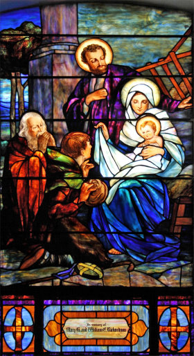 stained-glass church window depicting the nativity