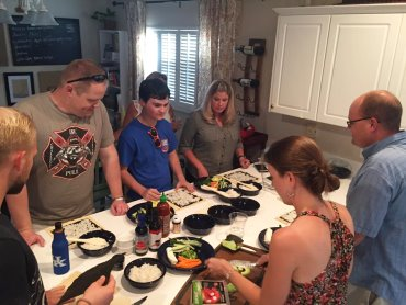 Group making homemade sushi