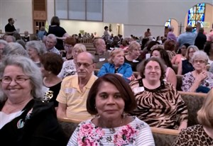 Attendees sit in the pews at a Nehemiah Action planning rally.