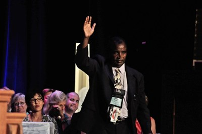 Dr. Silas M'Mworia salutes the Annual Conference crowd