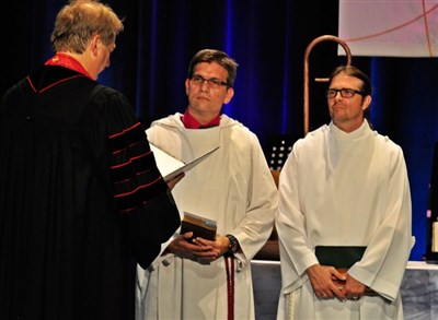 Bishop Ken Carter ordains deacons Jeremy Herrington and Justin LaRosa