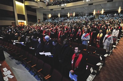Ordinands and supporters fill seats in auditorium