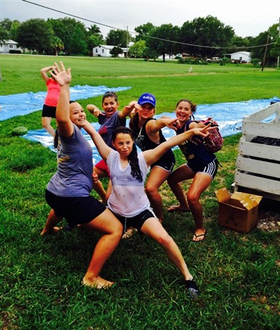 Moore Haven youth pause for group shot in front of slip and slide