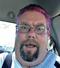 Pastor Charley Watts with pink hair