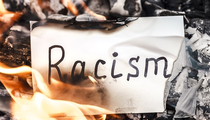 bigstock-white-paper-with-words-racism--372476311.jpg