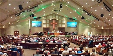 Packed pews for a worship service at Faith UMC, Fort Myers
