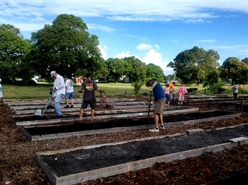 Volunteers planting in boxed rows at Cason UMC community garden