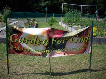 Garden for God banner in front of Shores UMC community garden