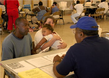UMCOR/FEMA worker interviewing distressed family