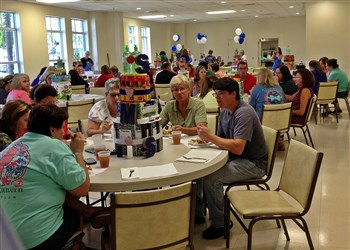 Teachers enjoy lunch in decorated church fellowship hall