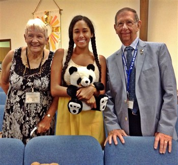 Kyra Liedtke, center holding a stuffed bear, is flanked by grandparents Janet and George Milroy