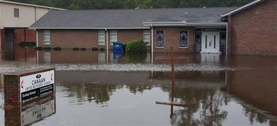 Canaan UMC in South Carolina with water at the sandbagged front doors