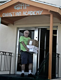 Hank Lunsford toting boxes of food donations for GAP food pantry