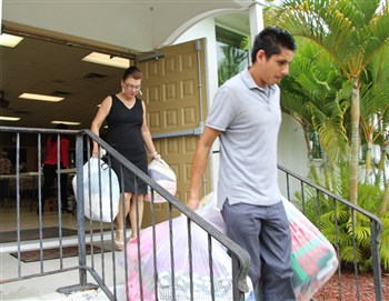 David Carrillo leaves Manatee UMC with bags of clothes and gifts for migrant families