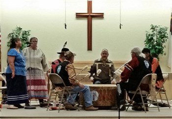 Sacred Thunder Drum performing with large drum at front of church sanctuary