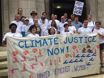 Picture of United Methodist Women holding Climate Justice sign