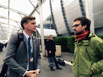 John Hill and Daniel Obergfell of United Methodist Church and Society talk at climate summit venue in Paris