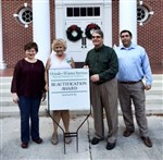 Rev. Dora Thomas, Laurian Rauen, Rev. David Harris and Todd Sykes in front of First UMC, Oviedo
