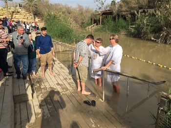 Ordinand Tony Fotsch renews baptismal vows at Jordan River, Holy Land trip