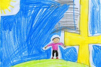Child's drawing of smiling visitor in front of cross