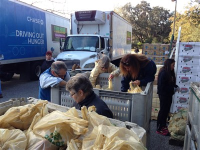 Volunteers working in front of Driving Out Hunger truck